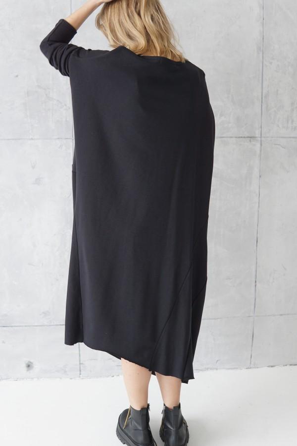 black dress with decorative seams